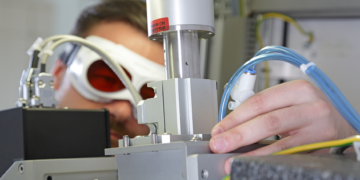 Engineer working on laser machine